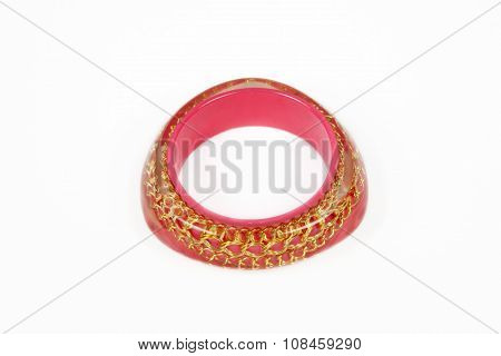 Pink bracelet on a white background.