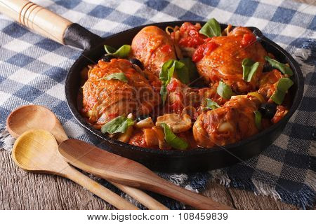Italian Cuisine: Chicken Cacciatori Close Up In A Pan. Horizontal