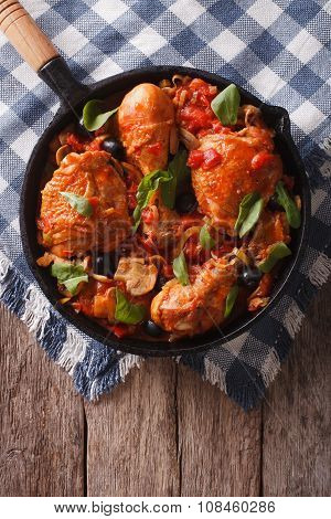 Cacciatori Chicken With Mushrooms And Olives In A Pan. Vertical Top View