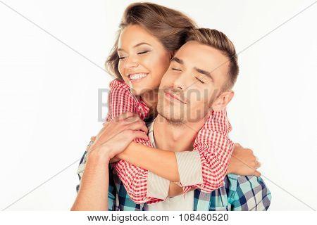 Pretty Young Woman Embracing Her Boyfriend Closing Eyes