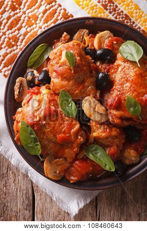 Italian Cacciatori Chicken Closeup On A Plate . Vertical Top View