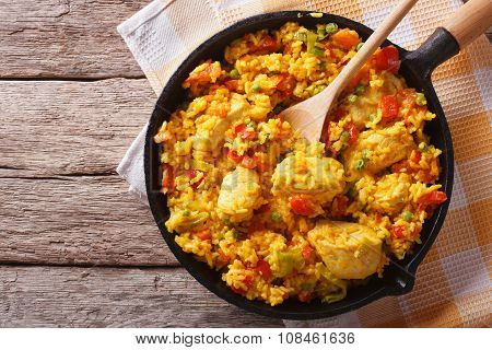 Hispanic Cuisine: Arroz Con Pollo In A Pan. Horizontal Top View