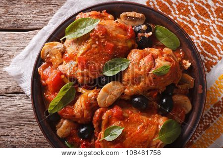 Italian Cacciatori Chicken Closeup On A Plate. Horizontal Top View