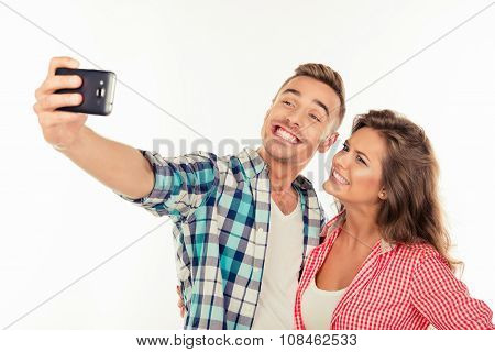 Cheerful Funny Couple In Love Making Selfie Photo With Telephone