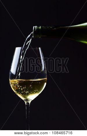 Wine Being Poured Into A Wineglass