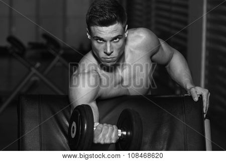 Bodybuilder Exercise With Dumbbells
