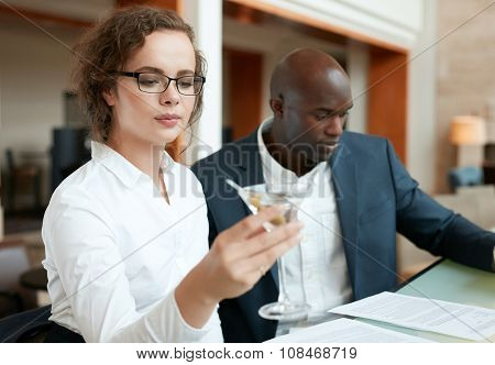 Businesspeople At Cafe After Work