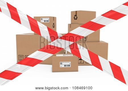 Dangerous Parcels Concept - Stack Of Cardboard Boxes Behind Red And White Barrier Tape Cross