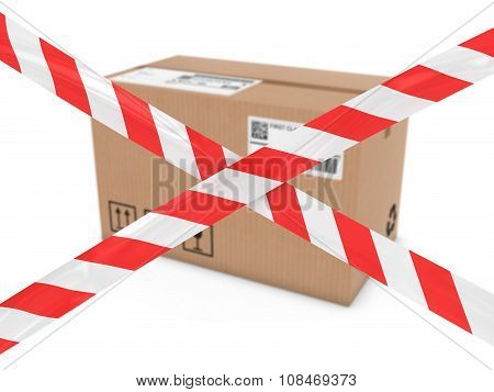 Suspicious Parcel Concept - Cardboard Box Behind Striped Hazard Tape