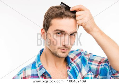 Handsome Young Man Combing His Hair