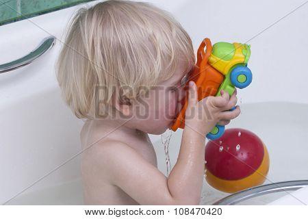 Cute, young boy take a bath.