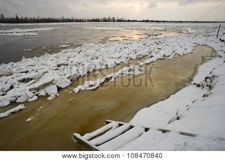 The first snow and  ice on Ob river.