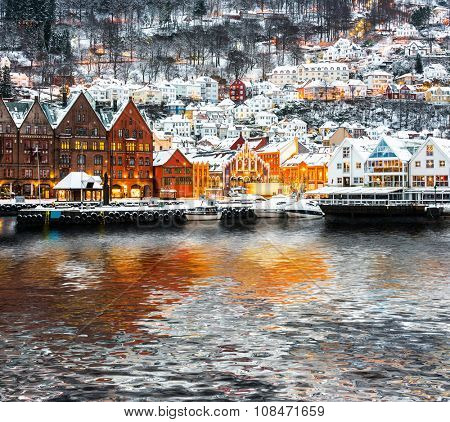 Bryggen street with wooden houses  with reflection in Bergen at Christmas, Norway