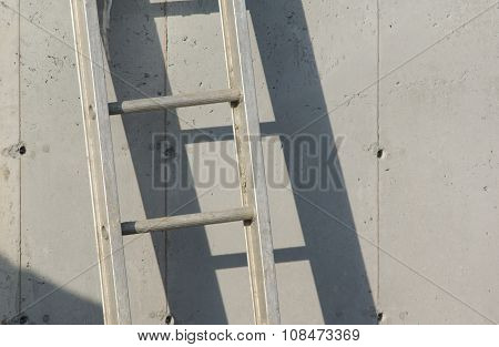 ladder on gray concrete wall