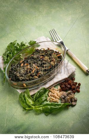 oven spinach with pine nuts dried grape and capers