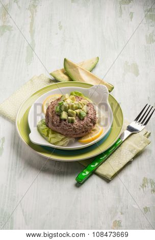 healthy hamburger with avocado and lettuce salad