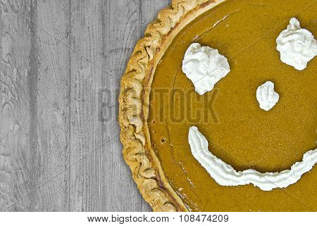 Thanksgiving pumpkin pie with happy face