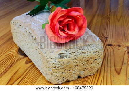 Homemade Sourdough Rye Bread With Red Rose On A Wooden Table