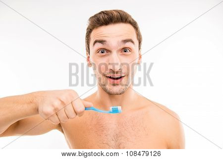 Cheerful Young Man Holding Toothbrush