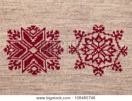 Brown knitted fabric with red christmas ornament