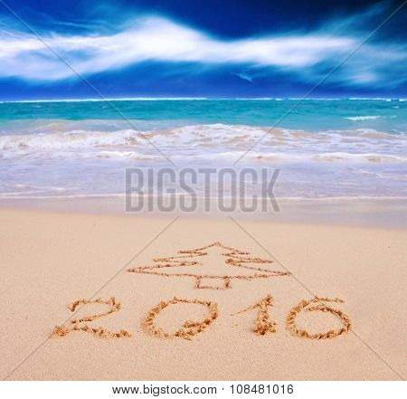 New Year 2016 written on sandy beach.