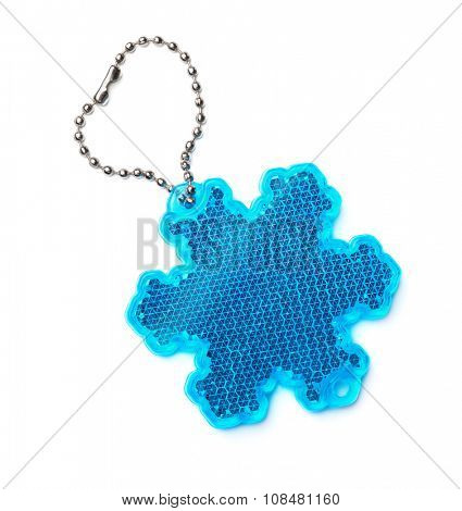 Snowflake safety reflector keyring isolated on white