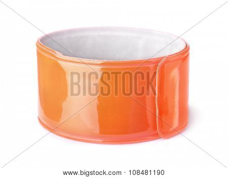 Orange reflective snap band isolated on white