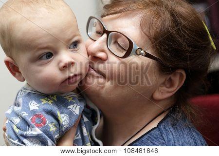 Grandmother Kissing Her Grandson