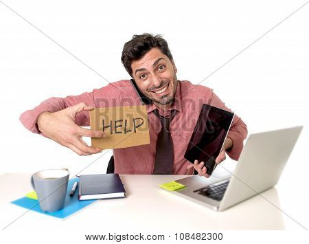 Overworked Businessman Busy At Office Desk Working On Computer Mobile Phone And Digital Tablet Askin