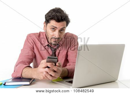 Young Attractive Businessman Working At Office Desk With Mobile Phone And Computer Laptop Looking Bo