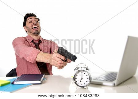 Businessman In Stress At Office Computer Desk Pointing Hand Gun To Alarm Clock In Out Of Time And Pr