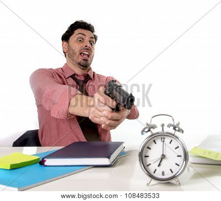 Businessman In Stress At Office Desk Pointing Hand Gun To Alarm Clock In Out Of Time And Project Dea