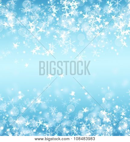 Blue abstract Christmas background with stars and bokeh