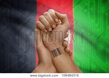 Barcode Id Number On Wrist Of Dark Skinned Person And National Flag On Background - Afghanistan