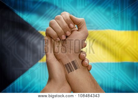 Barcode Id Number On Wrist Of Dark Skinned Person And National Flag On Background - Bahamas