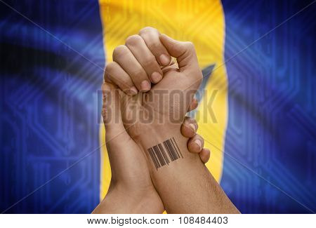 Barcode Id Number On Wrist Of Dark Skinned Person And National Flag On Background - Barbados