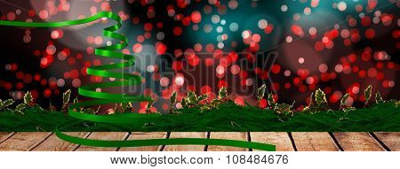 Green christmas tree ribbon against digitally generated twinkling light design