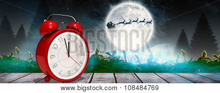 Alarm clock counting down to twelve against digitally generated grey wooden planks