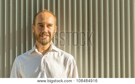 Portrait of a man against a corrugated iron background