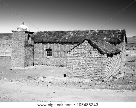Small rural andean style church made of unfired clay bricks