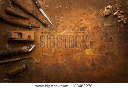Hand tools Wood (Drill Jig Saw plane chisel) on an old wooden workbench