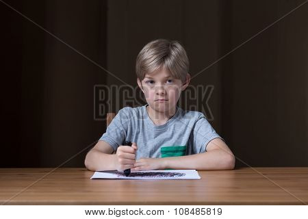Schoolchild Drawing On The Paper