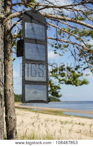 Phone Charges Via Usb Cable From The Portable Foldable Solar Panel