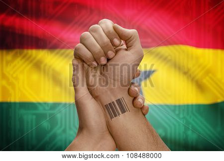 Barcode Id Number On Wrist Of Dark Skinned Person And National Flag On Background - Ghana