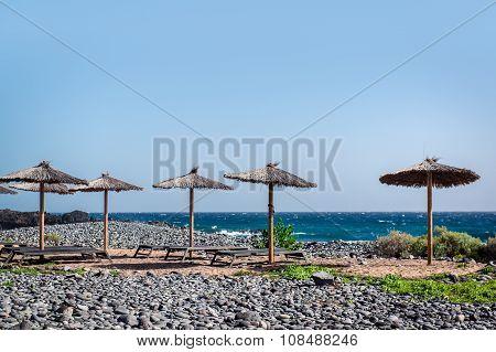 Sun Umbrellas And Deckchairs On Empty Beach. Tenerife, Canary Islands. Spain