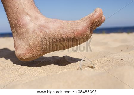 Man Goes On The Beach And The Risk Of Stepping On A Splinter Of Broken Bottle Glass