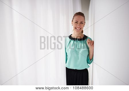 Female service worker with beautiful smile standing in modern interior