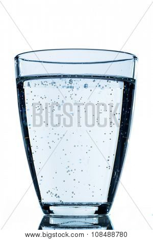 glass of water against white background, symbol photo for drinking water, water demand and consumption
