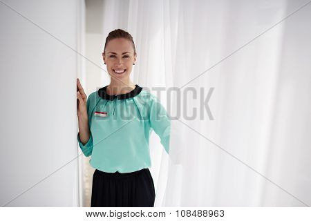 Half length portrait of young charming woman consultant with beautiful smile posing
