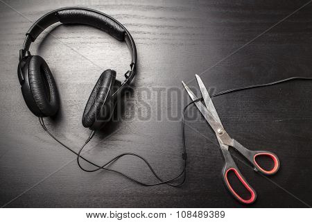 Scissors Cut The Wire From The Headphones, And Thus Stop The Very Loud Illegal Pirated Music